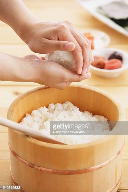 Young Japanese woman preparing Onigiri rice balls