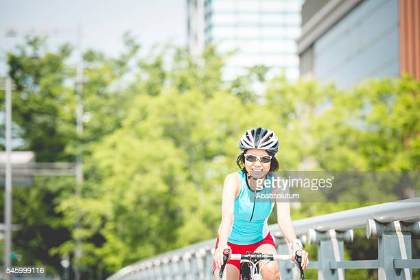 Young Japanese Woman Riding a Bike in Kyoto City, Japan