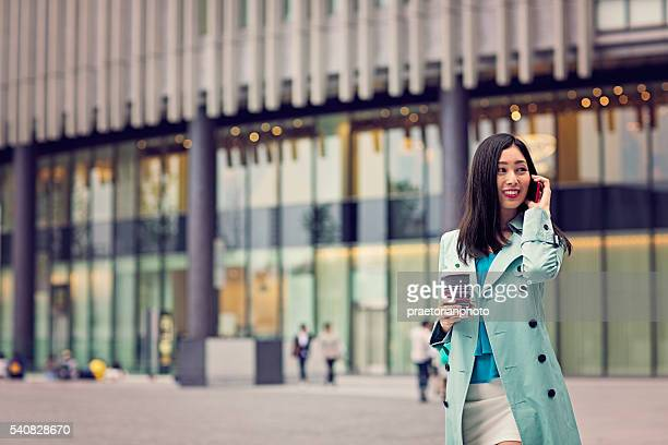 Young Japanese woman using mobile phone