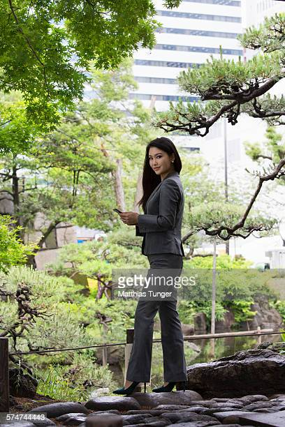 Young Japanese woman with her touch pad