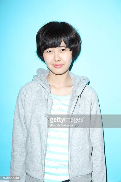 Young Japanese woman,blue background