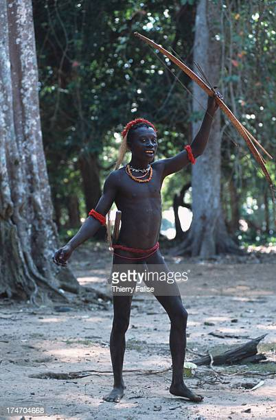 Young Jarawas shows off his hunting equipment a bow and arrow
