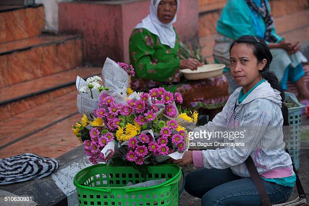 Young Javanese lady selling flower at morning traditional market in Salatiga, a small city in Central Java province. She sells the flower in the...