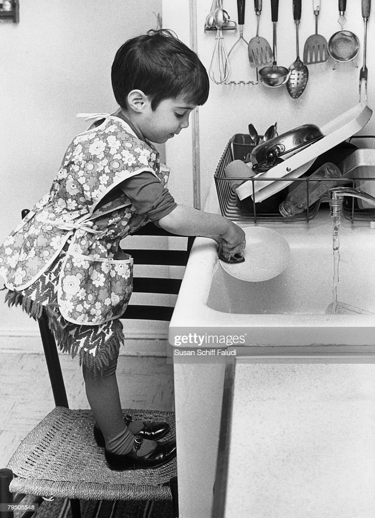 Young Jean helps out with the washing up, circa 1955.