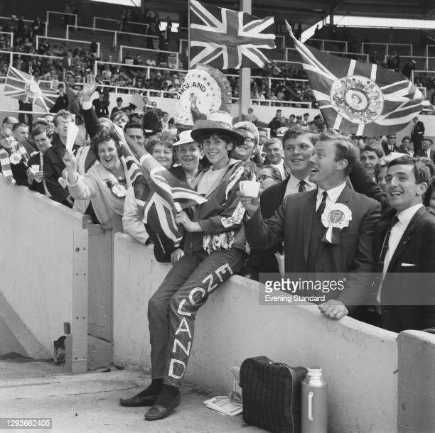 Young Jean Nicholson is among the England fans at Wembley Stadium in London during the World Cup Final between England and West Germany, UK, 30th...
