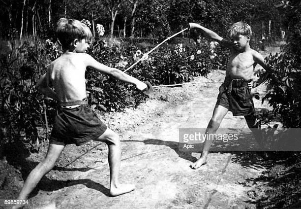 Young Jean-Paul Belmondo with his brother Alain playing in Clairefontaine, c. 1940