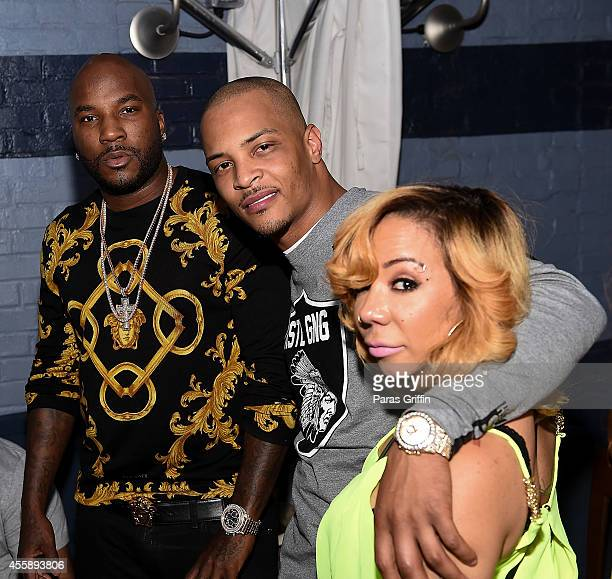 """Young Jeezy, Clifford """"T.I."""" Harris, and Tameka """"Tiny"""" Harris attend """"Festa De Rei - Feast of Kings"""" at Little Italia on September 21, 2014 in..."""