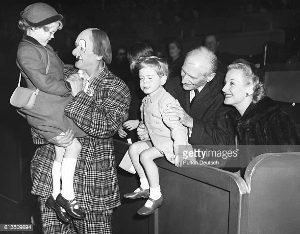Young Jeremy Soames and his sister Emma are introduced to the worldfamous entertainer Coco the Clown at an opening luncheon given by the Bertram...