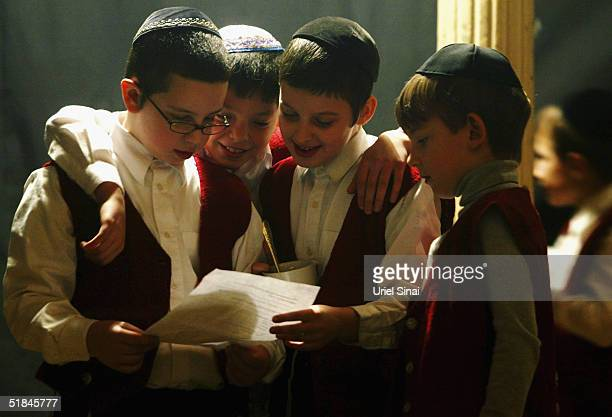 Young Jewish children rehearse for a Hanukah play at a heder or Torah school December 9 2004 in the Ukranian port city of Odessa A thriving jewish...