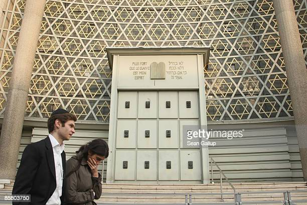 A young Jewish couple walk past the Synagogue de la Paix synagogue April 4 2009 in Strasbourg France Strasbourg is home to approximately 16000 Jews...