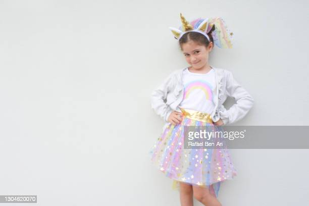 young jewish girl dressed as a unicorn on purim jewish holiday - rafael ben ari photos et images de collection