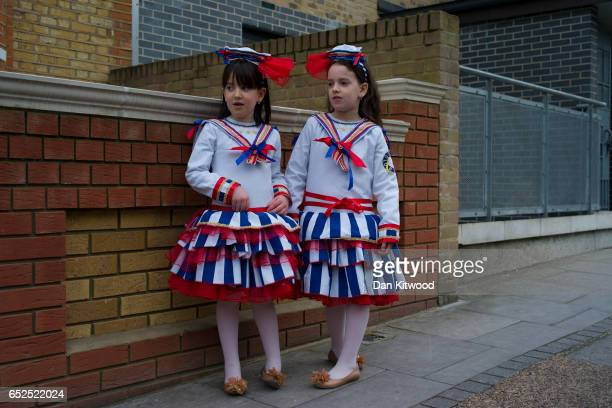Young Jewish girls stand outside a home during the annual Jewish holiday of Purim on March 12 2017 in London England Purim is celebrated by Jewish...