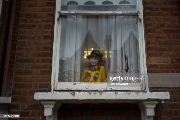 A young Jewish looks from a window during the annual Jewish holiday of Purim on March 12 2017 in London England Purim is celebrated by Jewish...