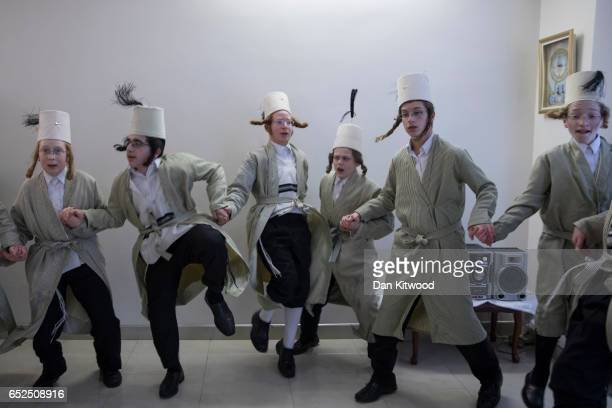 Young Jewish men dance around a local business man's home during the annual Jewish holiday of Purim on March 12 2017 in London England Purim is...