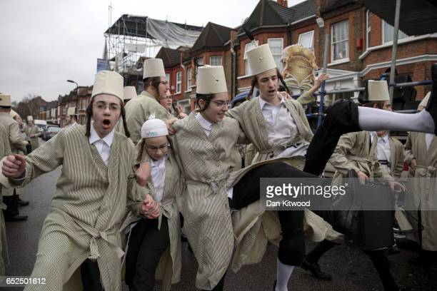 Young Jewish men dance down a street during the annual Jewish holiday of Purim on March 12 2017 in London England Purim is celebrated by Jewish...