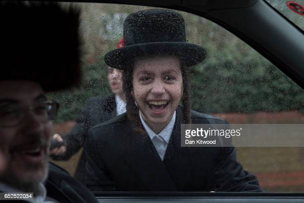 Young Jewish men stop cars to ask for money during the annual Jewish holiday of Purim on March 12 2017 in London England Purim is celebrated by...