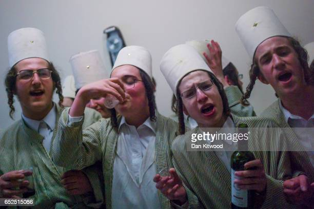 Young Jewish men visit a local business man's home for food and drink during the annual Jewish holiday of Purim on March 12 2017 in London England...