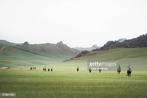 Young jockeys race toward the finish line during a small Naadam festival in Ugtaal Soum Mongolian pastoral herders make up one of the world's largest...