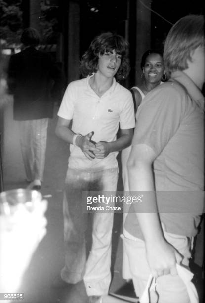 UNDATED FILE PHOTO A young John F Kennedy Jr walks with friends in this undated file photo July 16 2000 marks the oneyear anniversary of the plane...