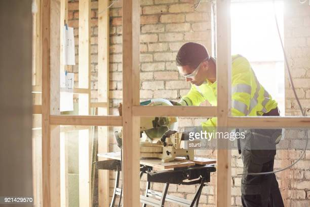 young joiner working on site - foundation make up stock pictures, royalty-free photos & images