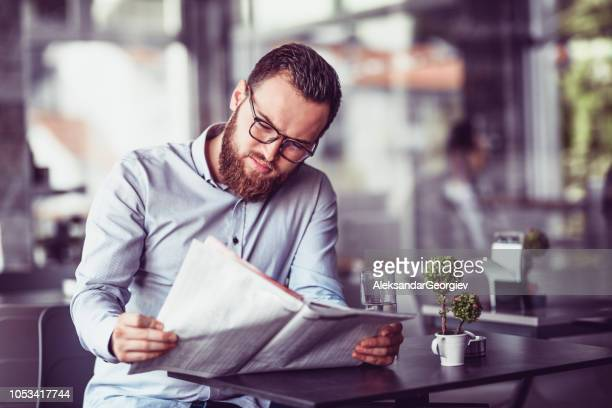 Young Journalist Enjoying Morning Coffee With Newspaper
