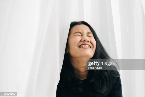 young joyful asian women - rifka hayati stock pictures, royalty-free photos & images