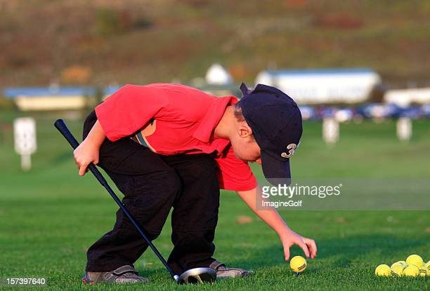 Young Junior Golfer Teeing it Up