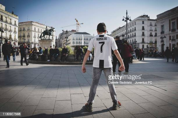 A young Juventus Fan wearing a Cristiano Ronaldo shirt enjoys the prematch atmosphere ahead of the UEFA Champions League Round of 16 First Leg match...