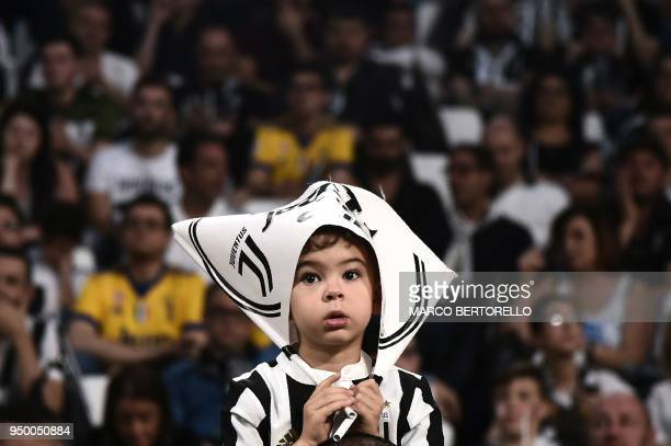 Young Juventus'supporter looks on during the Italian Serie A football match between Juventus and Napoli on April 22, 2018 at the Allianz Stadium in...