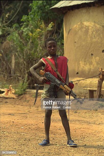 A young 'Kamajor' who has come from Sierra Leone to fight the RUF alongside the Guinean Army