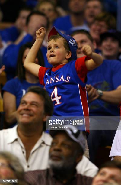 A young Kansas fan cheers during the game between the Oklahoma State Cowboys and the Kansas Jayhawks on February 7 2009 at Allen Fieldhouse in...
