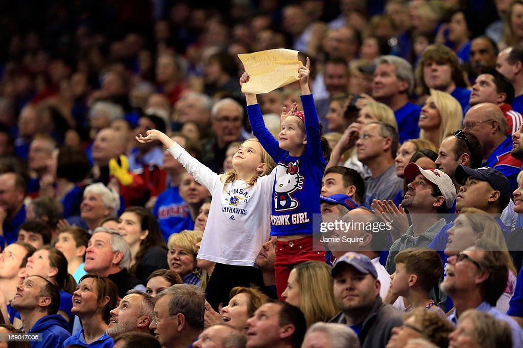 Young Kansas Jayhawks fans cheer during the game against the Temple Owls at Allen Fieldhouse on January 6, 2013 in Lawrence, Kansas.