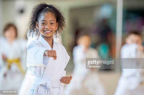 young karate class - martial arts stock pictures, royalty-free photos & images