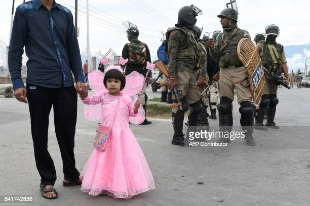 A young Kashmiri girl looks on during clashes between protestors and Indian government forces in Srinagar on September 2 2017 Clashes broke out after...