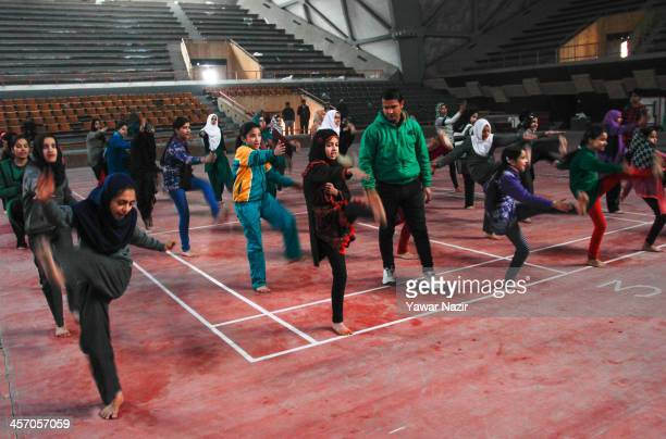 Young Kashmiri Muslim girls practice inside indoor stadium on December 16 2013 in Srinagar the summer capital of Indian administered Kashmir India As...