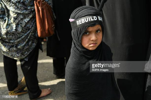 Young kid dressed in black at the Town Hall during a protest against the demolition of Janat Ul Baqi graveyard. Shia Muslims in Bangalore came...