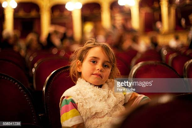 young kid in a opera house or theatre - opernhaus stock-fotos und bilder