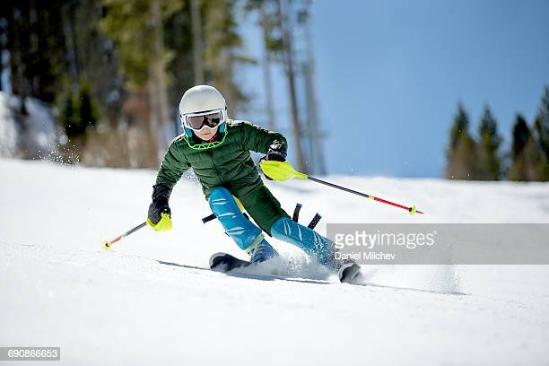 young kid racing skis on a sunny day. - selective focus stock pictures, royalty-free photos & images