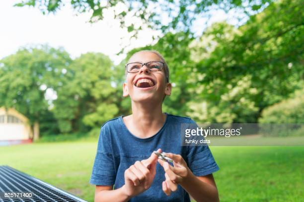 Young kid using hand spinner