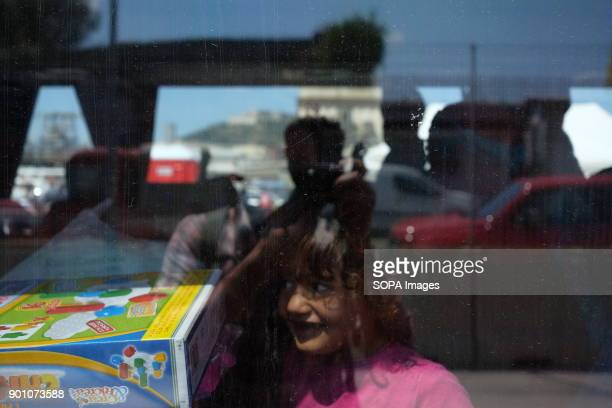A young kid waits for her family inside a bus during landing operations in Naples at Carmine's pier On May 28th 2017 'Vos Prudence' a rescue boat of...