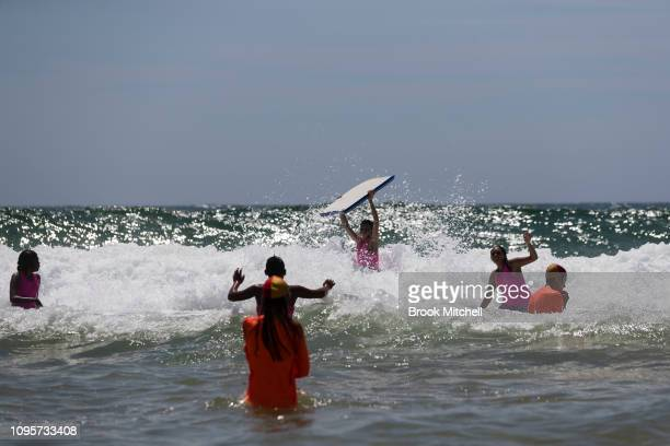 Young kids enjoy their first ever visit to the beach at South Narrabeen Beach on January 18 2019 in Sydney Australia The 40 children from Far North...