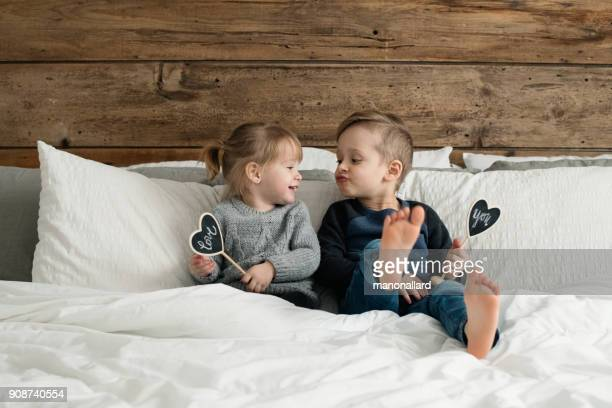 young kids happy childrens family playing in the parent's bed - barefoot stock pictures, royalty-free photos & images