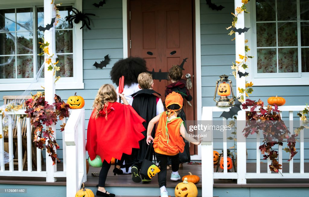 Young kids trick or treating during Halloween : Stock Photo