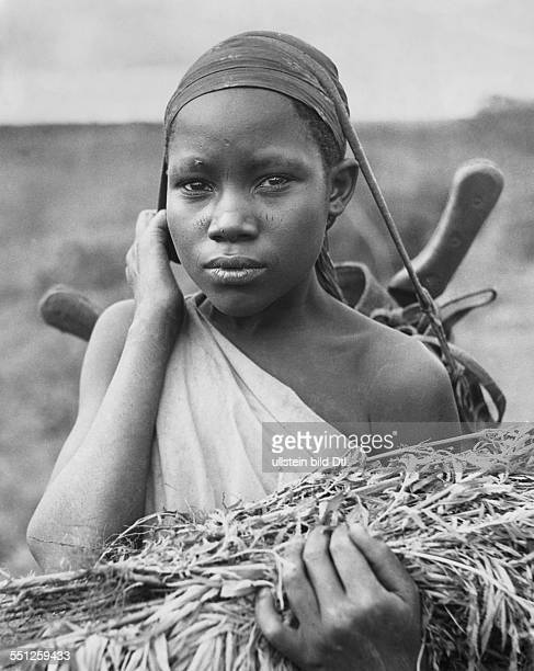 A young Kikuyu woman photographed near Nyeri Kenya British East Africa By Claude Jacoby