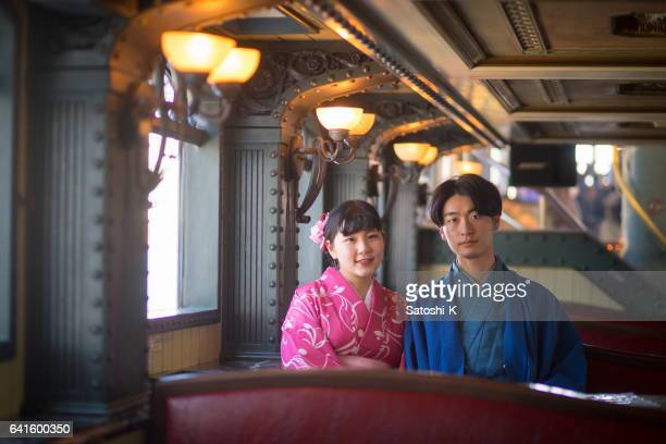 young kimono couple in antique interior - traditional clothing stock photos and pictures