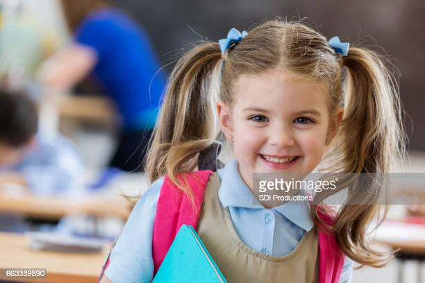 Young kindergarten student at school