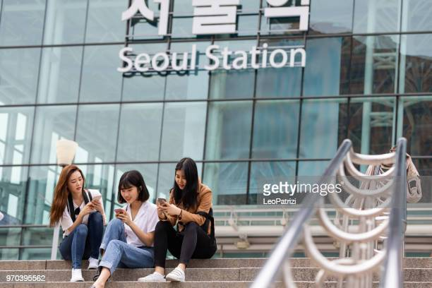 young korean tourists just arrived in the seoul - south korea stock pictures, royalty-free photos & images