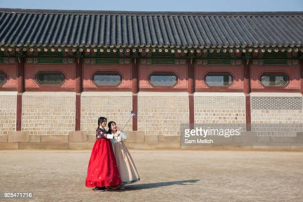 Young Koreans in Hanbok's traditional Korean dress pose for photos at the Gyeongbokgung Palace on 26th February 2018 in Seoul South Korea...