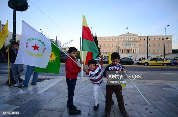 Young Kurdish boys hold flags of Kurdistan in Syntagma square Kurdish people living in Athens organized a demonstration in support of the Kurdish...