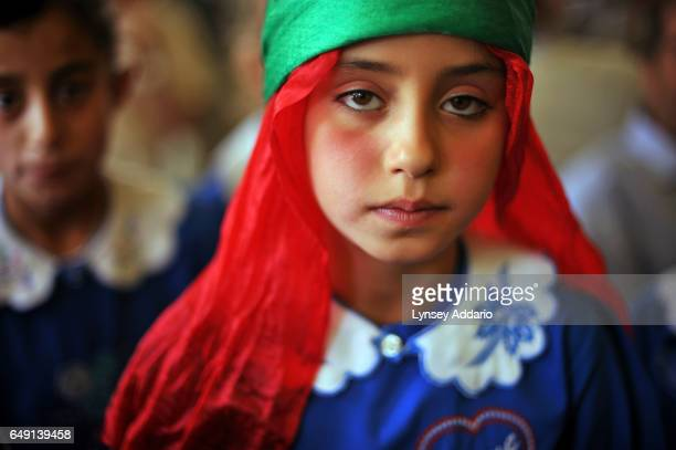 A young Kurdish girl waits for the start of a protest to demand the right to learn the Kurdish language in schools in Van Turkey on Sept 22 2008...